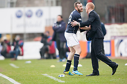 Dundee's Craig Beattie and Falkirk's manager Gary Holt.<br /> Dundee 0 v 1 Falkirk, Scottish Championship game played today at Dundee's Dens Park.<br /> © Michael Schofield.