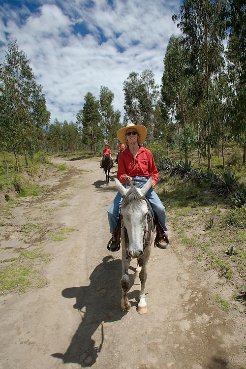 South America, Ecuador, Cayambe, horseback riders near Hacienda Guachala, built 1580   MR