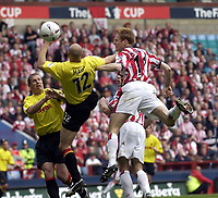 Copyright Sportsbeat. 0208 3926656<br />Picture: Henry Browne<br />Date: 13/04/2003<br />Watford v Southampton FA Cup Semi Final<br />Anders Svensson of Southampton beats Watford's Gavin Mahon but puts it wide