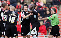 Photo: Paul Thomas.<br /> Doncaster Rovers v Swansea City. Coca Cola League 1. 17/02/2007.<br /> <br /> Adebayo Akinfenwa (9) and his team-mates celebrate his goal.