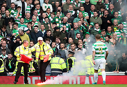 Stadium stewards put out a flair thrown onto the pitch during the second half of the Ladbrokes Scottish Premiership match at the Ibrox Stadium, Glasgow.
