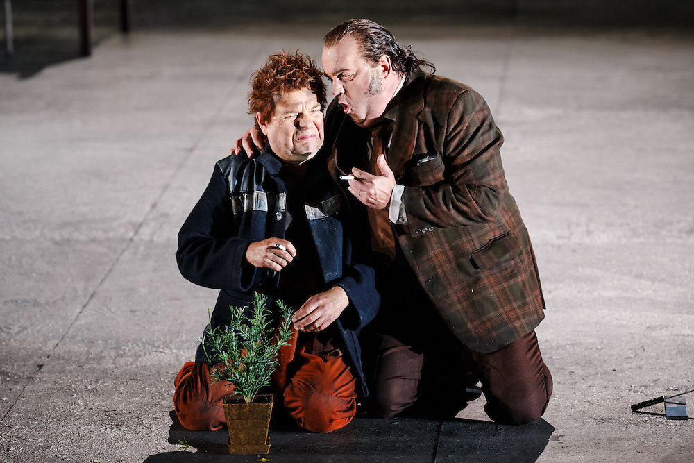 """LONDON, UK, 21 June, 2016. Left to right: Peter Hoare (as Laca Klemen) and Graeme Danby (as Foreman) rehearse for the revival of director David Alden's production of Janacek's opera """"Jenufa"""" at the London Coliseum for the English National Opera. The production opens on 23 June. Photo credit: Scott Rylander."""