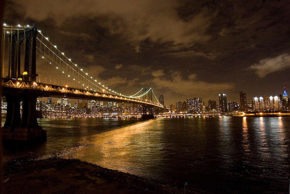 View of the Manhattan Bridge and Manhattan from DUMBO (Down Under the Manhattan Bridge Overpass), an arts district in Brooklyn, NY. USA
