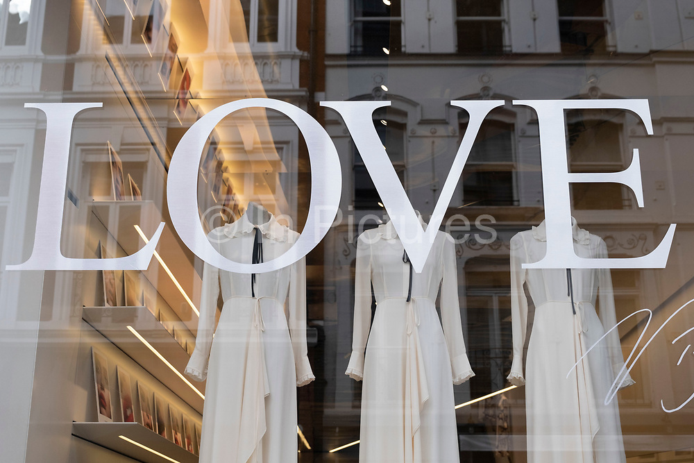 Love sign in the shop window of high end fashion retailer Victoria Beckham in Mayfair on 5th March 2021 in London, England, United Kingdom.