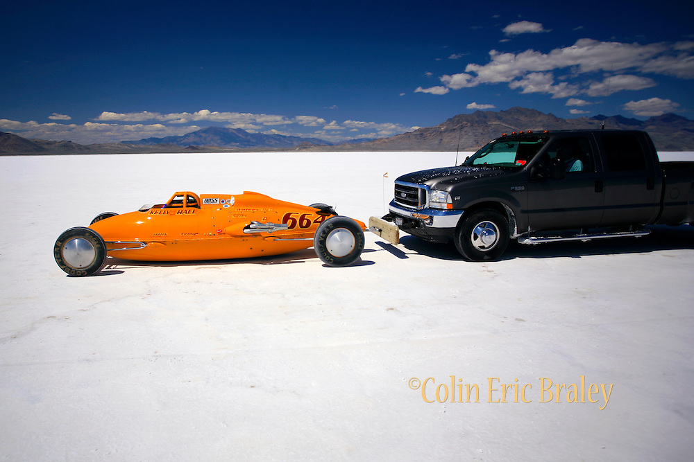 The best cars-people-atmosphere-photos of 2009 Bonneville Speed Week-  The Kelly & Hall Racing, 1997, P-38 Lakester, from Manhattan Beach, CA. is pushed back to the pits after making a run on the long track at the Bonneville Speed Way. August 9, 2009.  Photos by Colin E. Braley