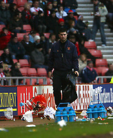Photo: Andrew Unwin.<br />Sunderland v Ipswich Town. Coca Cola Championship. 13/01/2007.<br />A Steward is despatched to attempt to clear up some of the rubbish blowing around the Stadium of Light.