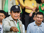 09 JANUARY 2016 - BANGKOK, THAILAND:       PRAYUTH CHAN-O-CHA, the Prime Minister of Thailand, waves and walks through crowd at Government House during Children's Day festivities at Government House. National Children's Day falls on the second Saturday of the year. Thai government agencies sponsor child friendly events and the military usually opens army bases to children, who come to play on tanks and artillery pieces. This year Thai Prime Minister General Prayuth Chan-ocha, hosted several events at Government House, the Prime Minister's office.      PHOTO BY JACK KURTZ