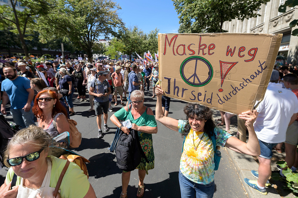 """01 AUG 2020, BERLIN/GERMANY:<br /> Demonstratin mit Schild """"Maske weg - Ihr seid durschaut!"""", Demonstration gegen die Einschraenkungen in der Corona-Pandemie durch die Initiative """"Querdenken 711"""" aus Stuttgart unter dem Motto """"Das Ende der Pandemie - Tag der Freiheit"""", Unter den Linden<br /> IMAGE: 20200801-01-033<br /> KEYWORDS: Demo, Protest, Demosntranten, Protester, COVID-19, Corona-Demo"""