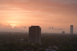 Houston, Texas skyline at sunrise viewed from the west.