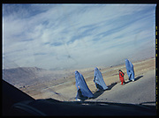 Afghan women in burqa walk in line near the Salang Pass, Afghanistan, Thursday, Nov. 30, 2006.