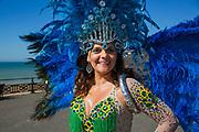 Carla Rezende, A Brazilian Passista with bright blue headpiece, during the Brighton Pride Parade on 6th August 2016 in Brighton in the United Kingdom.