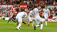 Brentford FC's Jota scores the firsy goal during the Sky Bet Championship game against Leeds United at Griffin Park