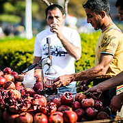 Selling fresh pomegranite juice on the streets of Istanbul, Turkey.