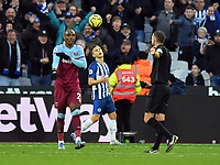Football - 2019 / 2020 Premier League - West Ham United vs. Brighton & Hove Albion<br /> <br /> West Ham United's Angelo Ogbonna shows Referee Michael Oliver where he thinks the ball hit Brighton & Hove Albion's Glenn Murray before he scores their 3rd goal, at The London Stadium.<br /> <br /> COLORSPORT/ASHLEY WESTERN