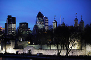 Th City of London and in particular the skyline of The Gerkhin looming behind the Tower of London at night. New and old, modernism and the ancient.