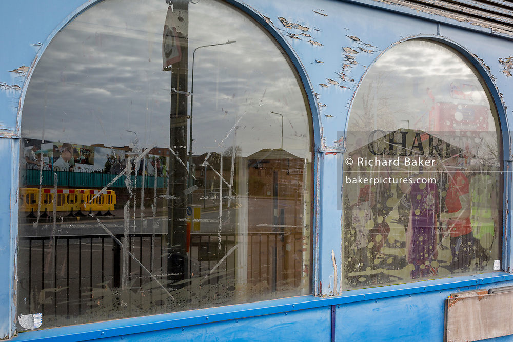 The peeling window of the 'Age Concern' charity in the London suburb of Swanley, on 3rd February 2020, in London, England
