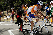 France, Bedoin, 25 July 2009: Laurens ten Dam (Ned) Rabobank gets assistance from a Dutch fan dressed as Elvis Presley during the climb through the forest to the summit of Mont Ventoux. Images from Stage 20 - Montélimar to Mont Ventoux (167 km). Photo by Peter Horrell / http://peterhorrell.com .