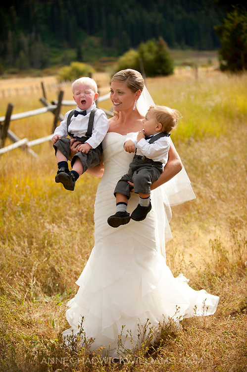 A bride holds two babies before her wedding at Plumb Jack, Squaw Valley, Tahoe.