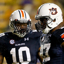 Sep 21, 2013; Baton Rouge, LA, USA; Auburn Tigers defensive end Elijah Daniel (97) and linebacker LaDarius Owens (10) against the LSU Tigers during the second half of a game at Tiger Stadium. LSU defeated Auburn 35-21. Mandatory Credit: Derick E. Hingle-USA TODAY Sports
