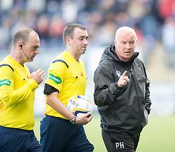 Falkirk's manager Peter Houston having words with ref Graham at half time.<br /> half time : Falkirk 1v 0 Dumbarton, Scottish Championship game played 20/9/2014 at The Falkirk Stadium .