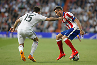 Real Madrid's Daniel Carvajal (L) and Atletico del Madrid´s Saul Niguez during quarterfinal second leg Champions League soccer match at Santiago Bernabeu stadium in Madrid, Spain. April 22, 2015. (ALTERPHOTOS/Victor Blanco)