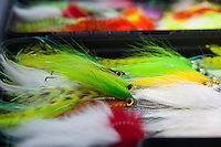assortment of large streamer flies for pike