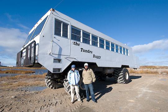 Cesar Ruano and Kaitlyn Casimo, PBI Leadership Students, mug in front of a Tundra Buggy. Churchill, Manitoba