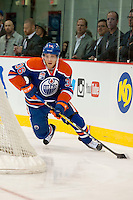 KELOWNA, CANADA - OCTOBER 2: Drake Caggiula #36 of the Edmonton Oilers skates behind the net with the puck <br /> against Los Angeles Kings on October 2, 2016 at Kal Tire Place in Vernon, British Columbia, Canada.  (Photo by Marissa Baecker/Shoot the Breeze)  *** Local Caption *** Drake Caggiula;