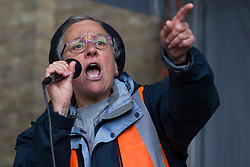 Southall, UK. 27th April 2019. Eve Turner of Ealing Trades Union Council and Ealing Save NHS addresses members of the local community and supporters at a rally outside Southall Town Hall to honour the memories of Gurdip Singh Chaggar and Blair Peach on the 40th anniversary of their deaths. Gurdip Singh Chaggar, a young Asian boy, was the victim of a racially motivated attack whilst Blair Peach, a teacher, was killed by the Metropolitan Police's Special Patrol Group during a peaceful march against a National Front demonstration.