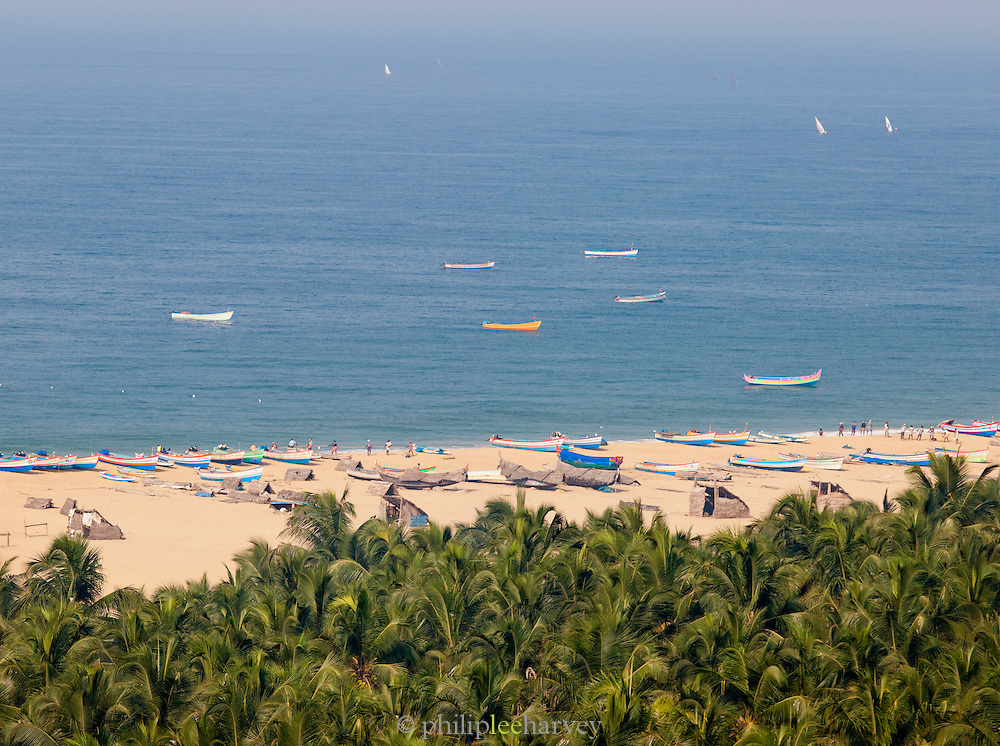 Moored fishing boats on Poovar Beach after a busy morning catch, near Trivandrum (Thiruvananthapuram), Kerala, India