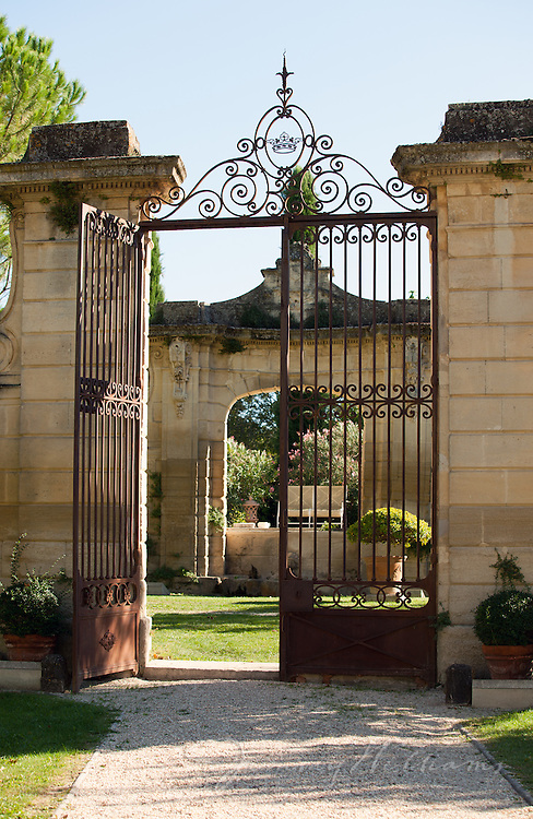 An old iron gate serves as the entrance to a chateau in Loriol-du-Comtat, France