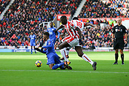 Demarai Gray of Leicester City (l) is brought down on the edge of the box by Kurt Zouma and Mame Biram Diouf of Stoke City. Premier league match, Stoke City v Leicester City at the Bet365 Stadium in Stoke on Trent, Staffs on Saturday 4th November 2017.<br /> pic by Chris Stading, Andrew Orchard sports photography.