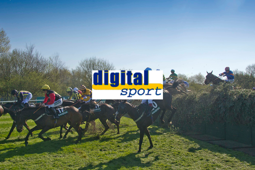 Grand National Meeting - Ladies' Day<br /> e.g. of caption:<br /> National Hunt Horse Racing - 2017 Randox Grand National Festival - Friday, Day Two [Ladies' Day]<br /> <br />   <br /> The field  jumps Beecher's Brook  in the 5th race 16.05  Randox Health Topham Handicap Chase (Grade 3) (National Course) (Class 1)<br /> 2m 5f 19y, Good (Good to Soft in places)<br /> 29 Runners.at Aintree Racecourse.<br /> <br /> COLORSPORT/WINSTON BYNORTH