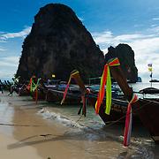 Tour longtail boats near Ko Rang Nok on Phra Nang beach in Krabi province, Thailand