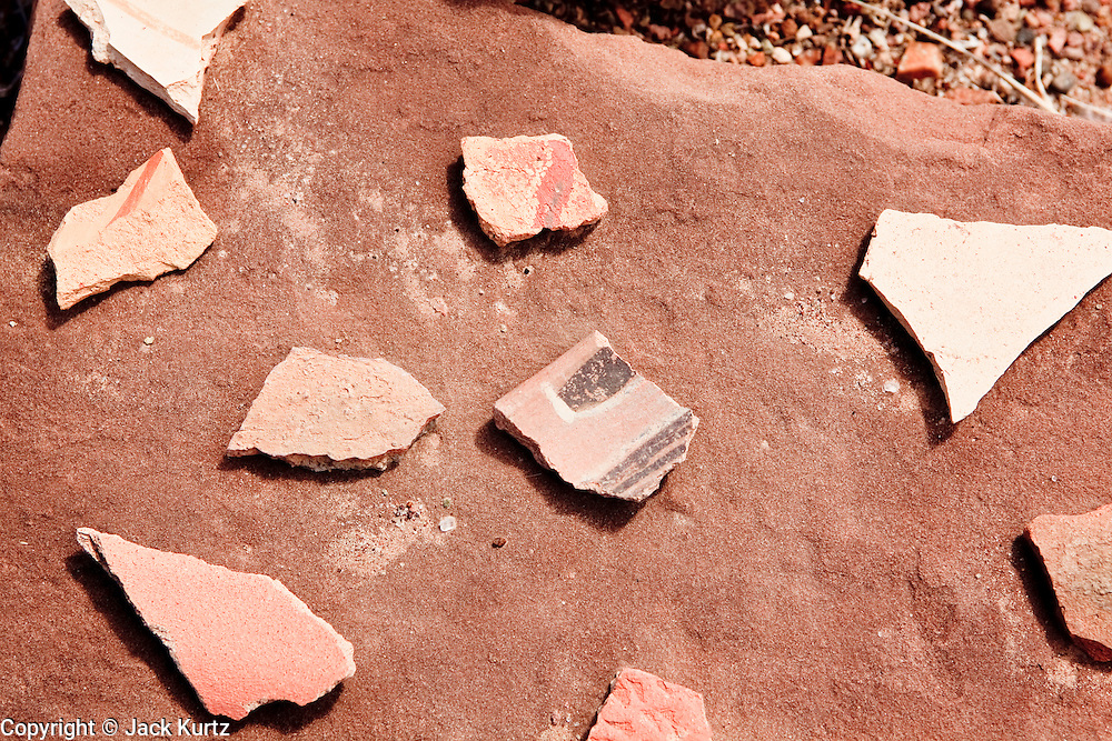 25 FEBRUARY 2010 -- WINSLOW, AZ: Pottery shards on a rock at Homolovi Ruins State Park north of Winslow. The park closed on Feb 22. The park's employees will spend the next few days packing up the park's exhibits but worry that the park's vulnerable archeological sites will be plundered by vandals and relic hunters when the park is vacant.   PHOTO BY JACK KURTZ
