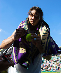 LONDON, ENGLAND - Monday, June 30, 2008: Rafael Nadal (ESP) signs autographs for fans as he walks off following his men's singles fourth round victory on day seven of the Wimbledon Lawn Tennis Championships at the All England Lawn Tennis and Croquet Club. (Photo by David Rawcliffe/Propaganda)