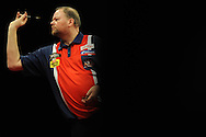 Raymond van Barneveld of Holland in action against James Wade. McCoy's Premier league darts, week 7 event at the Motorpoint Arena in Cardiff, South Wales on Thursday 21st March 2013. pic by Andrew Orchard, Andrew Orchard sports photography,