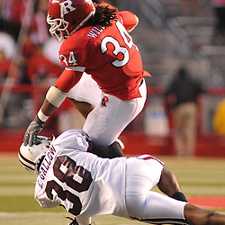 Oct 10, 2009; Piscataway, NJ, USA; Texas Southern safety Zack Gallow (38) tackles Rutgers running back De'Antwan Williams (34) during second half NCAA college football action in Rutgers' 42-0 victory over Texas Southern at Rutgers Stadium.