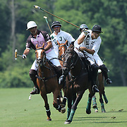 Matias Magrini, (left), K.I.G. and Hilario Ulloa, White Birch, challenge for the ball during the White Birch Vs K.I.G Polo match in the Butler Handicap Tournament match at the Greenwich Polo Club. White Birch won the game 11-8. Greenwich Polo Club, Greenwich, Connecticut, USA. 12th July 2015. Photo Tim Clayton