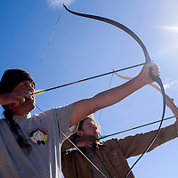 Henry Lind, left, and Galen Lind take aim on the archery range outside the Candy Kitchen Trading Post during a winter solstice celebration in Candy Kitchen Saturday.