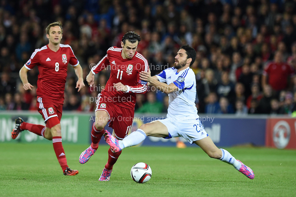 Gareth Bale of Wales is fouled by Marios Nikolaou of Cyprus. Euro 2016 qualifying group B match, Wales v Cyprus at the Cardiff city Stadium in Cardiff, South Wales on Monday 13th Oct 2014.<br /> pic by Andrew Orchard, Andrew Orchard sports photography.