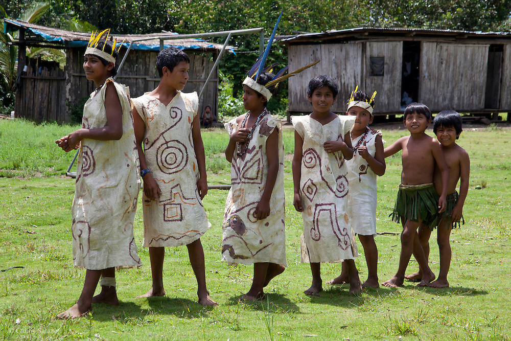 Children in traditional dress for dances performed for tourist group. Communidad Nativa de Queros-Wachiperi near Pilcopata. The Queros Community has a community cultural tourism project and holds the title to a conservation concession of almost 7000 hectares near their community. They are the first idigenous group to be granted management of a conservation concession in Peru. The concession is pre-montane rainforest and they hold the title for 40 years with hopes of renewal.