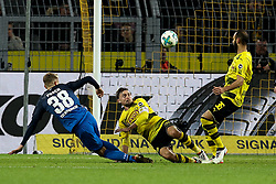 DORTMUND, Dec. 17, 2017  Marcel Schmelzer (C) of Dortmund fights for the ball during the Bundesliga match between Borussia Dortmund and TSG 1899 Hoffenheim at Signal Iduna Park on December 16, 2017 in Dortmund, Germany. Dortmund won 2-1. (Credit Image: © Joachim Bywaletz/Xinhua via ZUMA Wire)