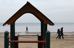 January 3, 2018 - Jurmala, Latvia - People walk on the embankment of the Gulf of Riga in Jurmala, 25 km from Riga. Latvia, Wednesday, January 3, 2018 The resort is famous for wooden Art Nouveau villas, Soviet-era sanatoriums and a long sandy beach. (Credit Image: © Danil Shamkin/NurPhoto via ZUMA Press)