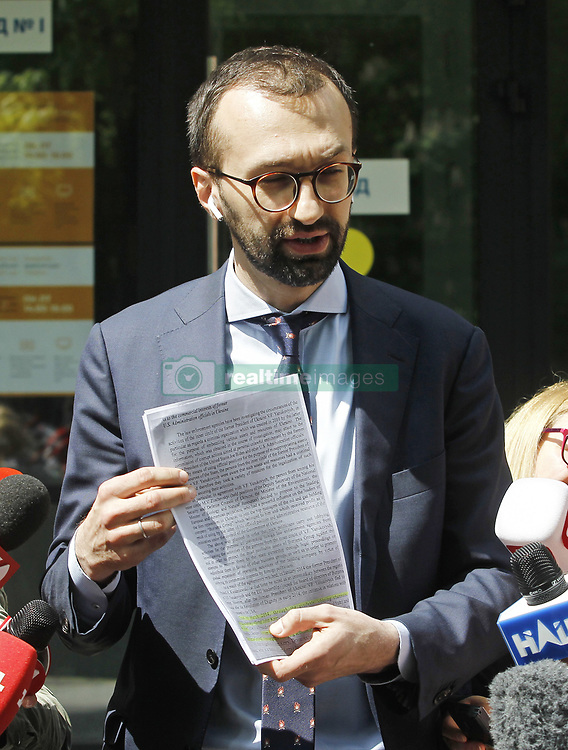 May 13, 2019 - Kiev, Ukraine - Ukrainian member of parliament SERHIY LESHCHENKO displays to journalists documents, as he said, handed over from entourage of the Attorney General of Ukraine Yuriy Lutsenko to entourage of attorney of US president Donald Trump and former New York mayor Rudy Giuliani , as he visits for his court hearing in Appellate Administrative Court in Kiev, Ukraine, on 13 May 2019. Leshchenko claims that the Attorney General of Ukraine Yuriy Lutsenko misled attorney of US president Donald Trump and former New York mayor Rudy Giuliani that Leshchenko was convicted of meddling in the presidential elections in the United States 2016, and it Giuliani voiced on Fox News. Rudy Giuliani cancels Ukraine trip, says he'd be 'walking into a group of people that are enemies of the US', as Fox News channel reports earlier. (Credit Image: © Serg Glovny/ZUMA Wire)
