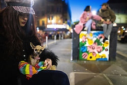 © Licensed to London News Pictures. 12/04/2021. Manchester, UK. A woman takes her pet dog out in Stevenson Square on a night out in Manchester City Centre as government restrictions to control the spread of Coronavirus are eased across the UK. Pubs, restaurants, hairdressers, gyms and non essential retailers are now permitted to serve customers within restrictions. Photo credit: Joel Goodman/LNP