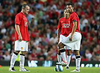 Photo: Paul Thomas.<br />Manchester United v Inter Milan. Pre Season Friendly. 01/08/2007.<br /><br />Dejected Wayne Rooney (L) and Ryan Giggs of Utd after Inter score their third goal.