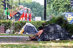 Tents are pitched in a semi-permanent camp on the central Island of Park Lane at Marble Arch. Over the last few years London has seen increasing numbers of Eastern European beggars and street performers on its streets as they flock to the UK and other wealthier countries to take advantage of people's generosity. London, August 02 2019.