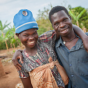 CAPTION: Namusisi (left) and Damyano (right) are a hearing impaired couple who have two children. They met at a SignHealth Uganda event and married soon after. Despite the fact that they have had no formal education and cannot read or write and, they live fulfilling lives thanks to the help that SignHealth provides. LOCATION: Kankamba Village, Lwengo District, Central Region, Uganda. INDIVIDUAL(S) PHOTOGRAPHED: Left: Namusisi Kato; right: Damyano Kato.