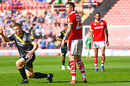 Daniel Pinillos of Barnsley (23) and Greg Docherty of Shrewsbury Town (8) in action during the EFL Sky Bet League 1 match between Barnsley and Shrewsbury Town at Oakwell, Barnsley, England on 19 April 2019.